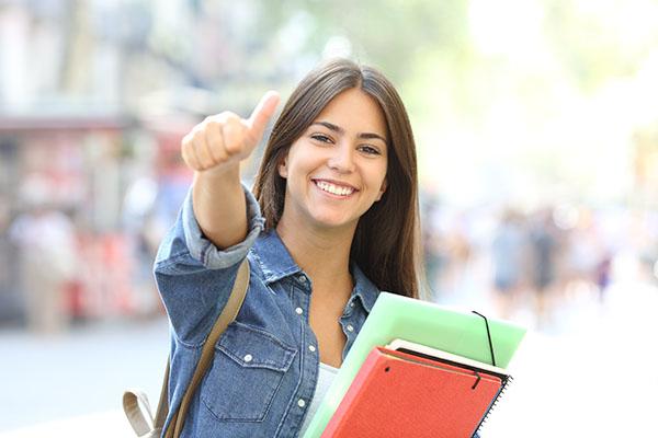 Happy student posing